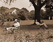 Relaxing in chairs under a shade tree on a summer day